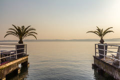 Lago de garde sunset. A sunset over lago de garde town, view from the pier Royalty Free Stock Images