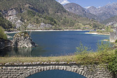 At the Lago dei Tramonti in Friuli. Old arched bridge leading over the course of the Meduna from the Lago dei Tramonti Stock Photos