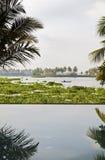 Lago del pescatore del raggruppamento di infinità di alba Immagine Stock