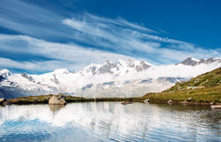 Lago della montagna della neve Immagini Stock
