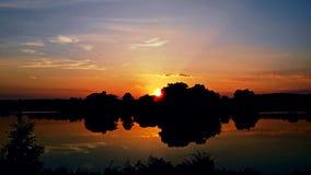 Lago di festa di tramonto Immagini Stock