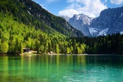 Lago di Fusine and monte Mangart. Beautiful panoramic view of fusine mountain lake, italy Royalty Free Stock Photo