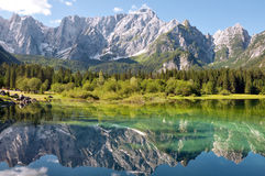 Lago di Fusine and monte Mangart reflex on lake Stock Photos