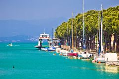 Lago di garda turquoise waterfront in Peschiera view stock photo