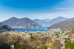 Lago di Lugano, Oporto Ceresio, Italia Vista aerea pittoresca di Oporto Ceresio e di Besano Fotografia Stock