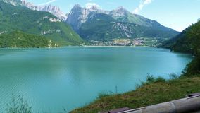 Lago Di Molveno Trentino Alto Adige. The most beautiful lake in Italy for the year 2018 It owes much of its charm to the natural setting that surrounds it: to royalty free stock image