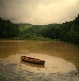 Lago e barca Cofee Fotografie Stock