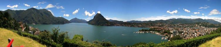 Lago e cidade de Lugano Fotos de Stock Royalty Free
