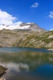 Lago e panorama del ghiacciaio con la montagna Kristallwand, alpi di Hohe Tauern, Austria Fotografie Stock