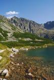Lago e rocce Immagini Stock