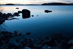 Lago en la puesta del sol Imágenes de archivo libres de regalías