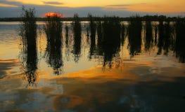 Lago en la puesta del sol Fotografía de archivo libre de regalías