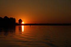 Lago en la salida del sol Fotos de archivo