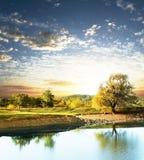 Lago en puesta del sol Fotos de archivo libres de regalías