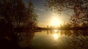 Lago en salida del sol Foto de archivo libre de regalías