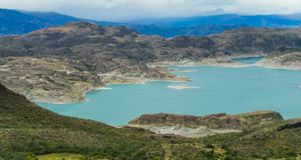 Lago General Carrera in Chile. Beautiful blue water and rocks lake and islands coast and cloudy sky. Lago General Carrera in Chile stock images