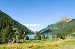 Lago Gioveretto - Zufrittsee. Peaceful landscape of north Italy with evergreen trees and blue lake Stock Photo
