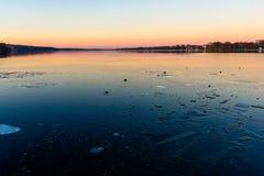 Lago helado en la puesta del sol Imágenes de archivo libres de regalías