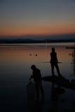 Lago - lake - di Varese at dusk, fisherman silhouette Royalty Free Stock Photos