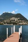 Lago Lugano y Mt Bre Imagen de archivo