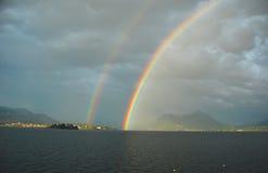 Lago Maggiore bajo el arco iris Imagenes de archivo
