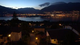 Lago Maggiore by night. Lago Maggiore on a september evening, as seen from Piazzogna (Ticino, Switzerland). Lago Maggiore is a large lake located on the south Stock Photos