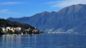 Lago Maggiore on a september morning (Switzerland). Looking over the Lago Maggiore (Ticino, Switzerland) and the village of Vira on a sunny september morning Stock Photography