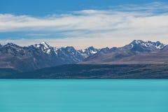 Lago magnifico Tekapo ed alpi del sud innevate, nuovo Zeala Fotografia Stock