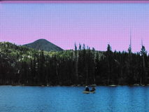 Lago Marie Snowy Mountains Wyoming canoe fotos de archivo