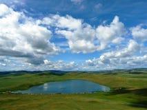 Lago na planície Fotografia de Stock Royalty Free