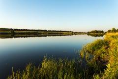 Lago no por do sol Fotografia de Stock