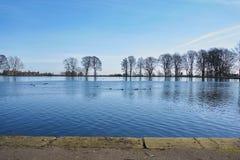 Lago park congelado a medias Imagen de archivo libre de regalías