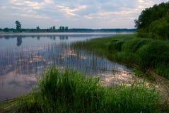 Lago por la mañana Fotos de archivo libres de regalías
