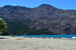 Lago Puelo. Argentinian lake at Patagonia with mountains behind, in Chubut Province, near El Bolsón Stock Images