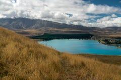 Lago Tekapo, valle e cielo nuvoloso drammatico, isola del nord Nuova Zelanda immagine stock