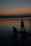 Lago - lake - di Varese at dusk, fisherman silhouette Royalty Free Stock Photos
