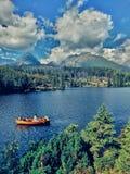 Lago y barco Fotografía de archivo
