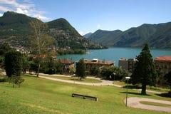 Lago y ciudad de Lugano Imagen de archivo libre de regalías