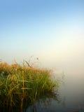 Lago y niebla morning Foto de archivo libre de regalías