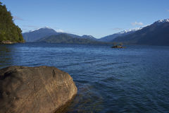 Lago Yelcho. In the Aysen Region of southern Chile. Large body of fresh water surrounded by lush forest and snow capped mountains royalty free stock images