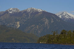Lago Yelcho. In the Aysen Region of southern Chile. Large body of fresh water surrounded by lush forest and snow capped mountains stock photo