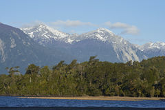 Lago Yelcho. In the Aysen Region of southern Chile. Large body of fresh water surrounded by lush forest and snow capped mountains royalty free stock image