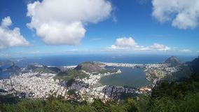 Lagoa, Botafogo Beach, mountainous landforms, sky, mountain, mountain range. Lagoa, Botafogo Beach is mountainous landforms, mountain range and cloud. That royalty free stock photos