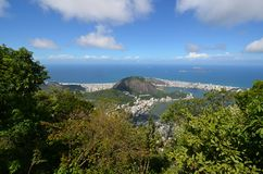 Lagoa, Botafogo Beach, sky, nature, coast, vegetation. Lagoa, Botafogo Beach is sky, vegetation and sea. That marvel has nature, cloud and promontory and that royalty free stock image