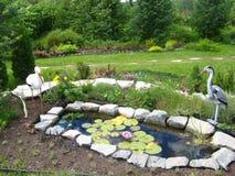 Lagoa decorativa no jardim Imagem de Stock Royalty Free