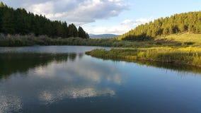 Lagoa e céu imagens de stock