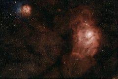 Lagoa e nebulosa Trifid fotografia de stock royalty free