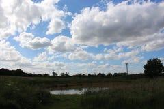 Lagoa e nuvem Imagens de Stock