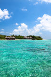 Lagoon and beach bungalows on Maldives Island Royalty Free Stock Photos