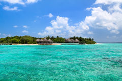 Lagoon and beach bungalows on Maldives Island Stock Photography